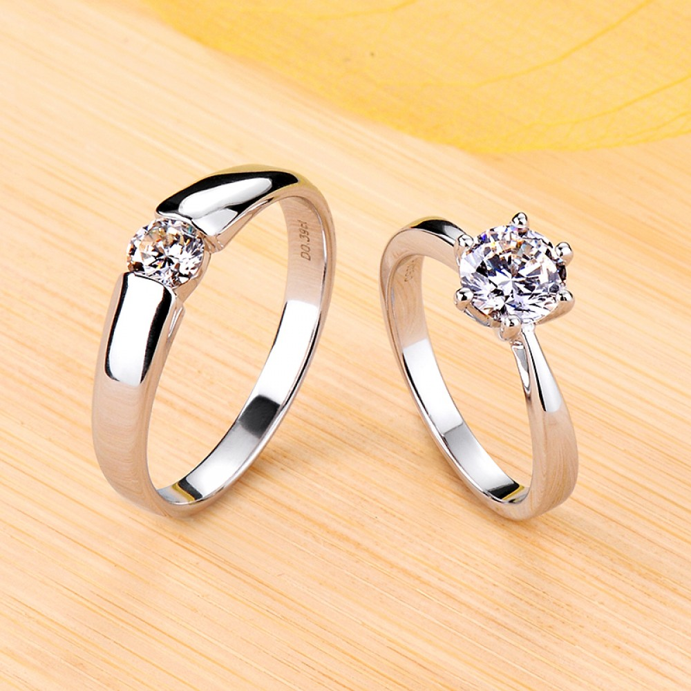 It is a photo of Engravable Round Cut Moissanite Couple Wedding Bands In Silver