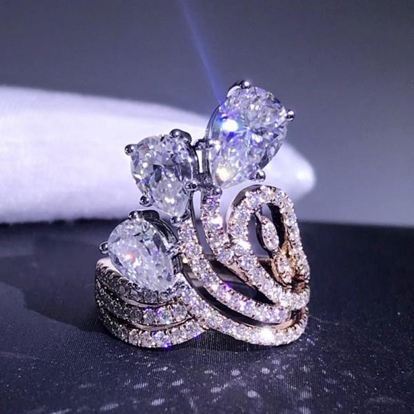 Oval Cut 3 Carat tw Flowers Moissanite Ring In 18K White Gold